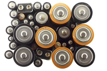 Many various batteries on the white background photo