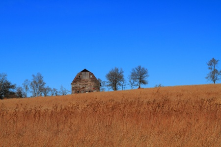 Beautiful fall landscape and old barn photo