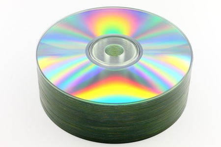 Close up of CDs on white background
