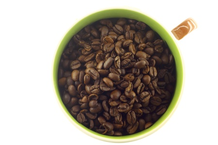 Cup with coffee beans o the white background