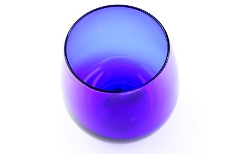 Blue cognac glass on the white background Banco de Imagens