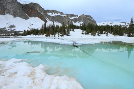 Frozen lakes in the Snowy Range Mountains of Wyoming photo