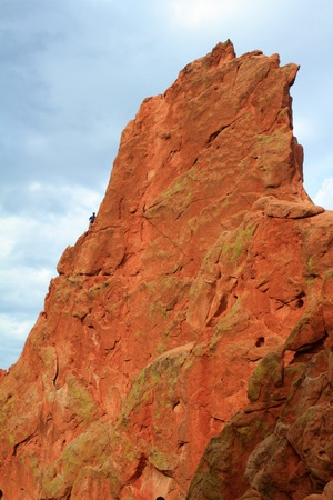 Person climbing the unusual rock formation in Garden of the Gods, Colorado, USA photo