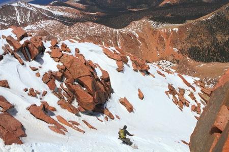 A man snowboarding in Pikes Peak Mountain in Colorado