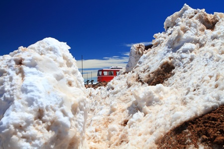 Winter scenery with piles of snow and a train on the top of Pikes Peak Mountain, Colorado, USA