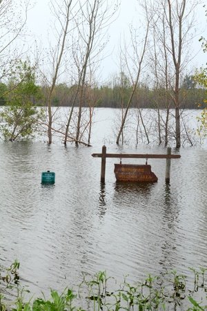 flood area: Waubonsie Wildlife Area sign  covered with flood water