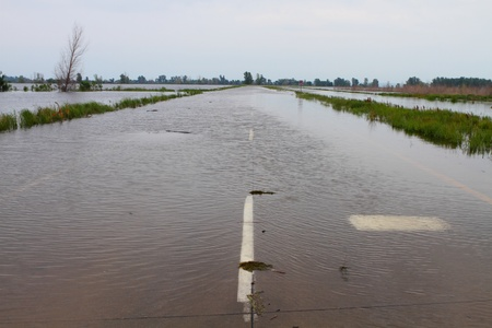 Highway in Midwest covered with flood water Stock Photo - 13072181