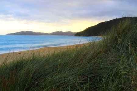 Beautiful sunset on sandy beach of Abel Tasman National Park, South Island, New Zealand Stock Photo - 13759493