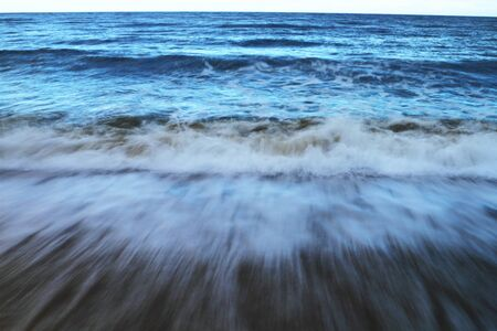 Strong tidal waves during sunset in Pacific Ocean