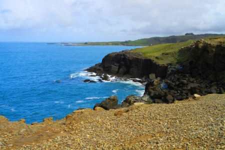 rugged terrain: Rocky outcrop and blue ocean in Catlins, New Zealand
