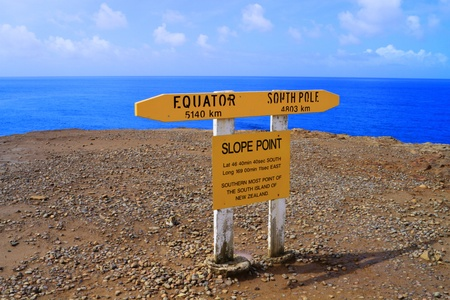 Signpost at the Slope Point stating that this is the southernmost point of the South Island of New Zealand photo