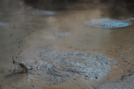Hot mud boiling in the geyser field in Rotorua, New Zealand photo