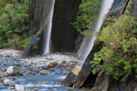 Beautiful waterfall in the forest in Westland Tai Poutini National Park, South Island, New Zealand photo