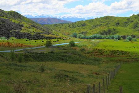 vistas: A road going through beautiful mountain vistas in  New Zealand