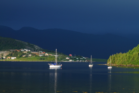 Boats and the harbor in the Nordic landscape of Newfoundland, Canada photo