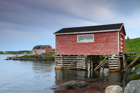 Nordic fisherman shacks raised on piles by the sea photo