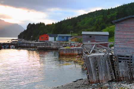 Picturesque fishing village during sunset in Nordic landscape photo