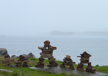 inukshuk: An inukshuk, a traditional stone sculptures made by indigenous people in Labrador, Canada Stock Photo