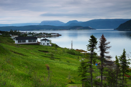 Picturesque fishing village in Nordic landscape photo