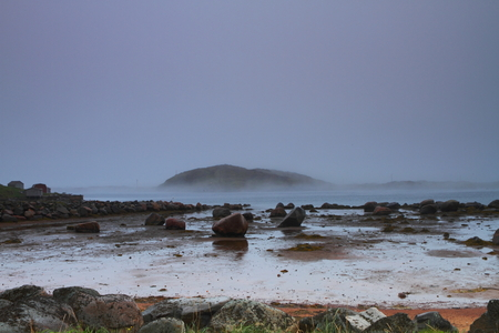 inlet bay: Rocky shore in rainy weather