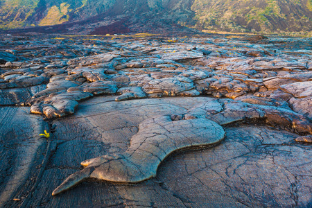 hawaii sunset: Amazing shapes and patterns of molten cooled lava landscape in the evening in Hawaii Volcanoes National Park, Big Island, Hawaii