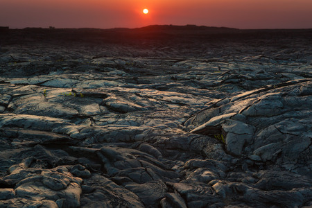 cooled: Beautiful sunset over molten cooled lava landscape in Hawaii Volcanoes National Park, Big Island, Hawaii