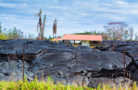 advancing: Home destroyed by advancing lava in the town of Pahoa, Big Island, Hawaii