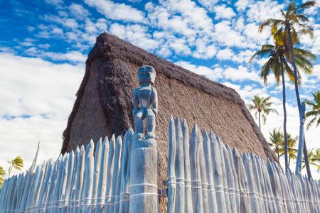 hawaii symbol: Hawaiian thatched roof dwellings at ancient Hawaiian site Puuhonua O Honaunau National Historical Park on Big Island, Hawaii