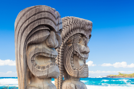 culture: Traditional Hawaiian wood carving of guards at ancient Hawaiian site Puuhonua O Honaunau National Historical Park on Big Island, Hawaii