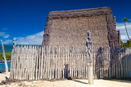 dwellings: Hawaiian thatched roof dwellings at ancient Hawaiian site Puuhonua O Honaunau National Historical Park on Big Island, Hawaii