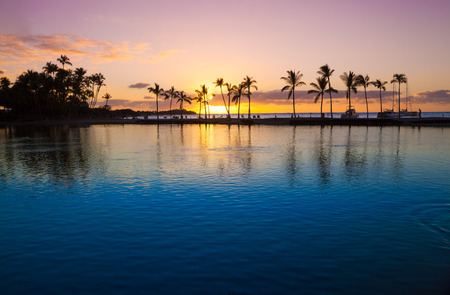blue romance: Beautiful sunset on Hawaiian beach, Big Island Stock Photo