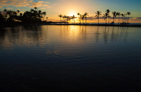 Beautiful sunset on Hawaiian beach, Big Island Stock Photo