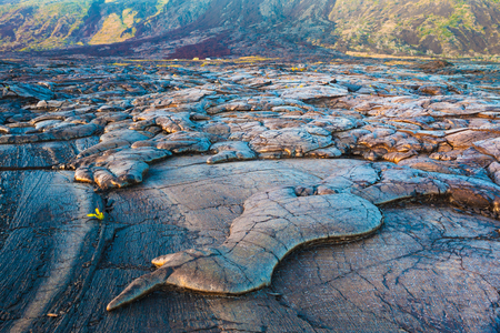 cooled: Amazing shapes and patterns of molten cooled lava landscape in the evening in Hawaii Volcanoes National Park, Big Island, Hawaii