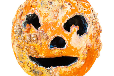 Old scary Halloween pumpkin on white background Stock Photo