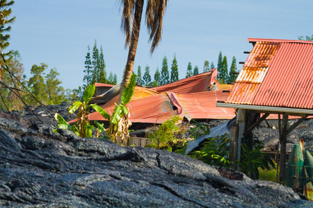 advancing: Home ruined by advancing lava in the town of Pahoa, Big Island, Hawaii Stock Photo