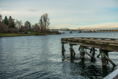 west end: View of the west end of the 520 bridge in Seattle. Lake Washington with a pier is in the foreground