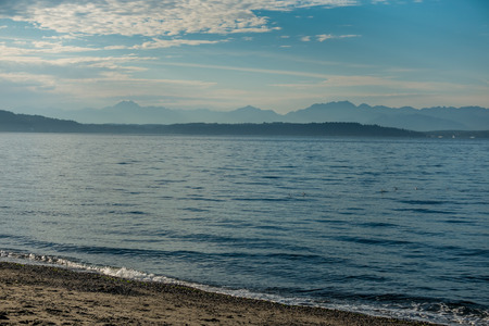 puget: The Cascade Mountains as seen from Alki Beach in West Seattle.