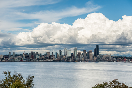 puget: Billowing clouds hover over the Seattle skyline.