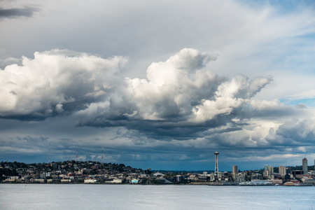 billowing: Billowing clouds hover over the Seattle skyline.