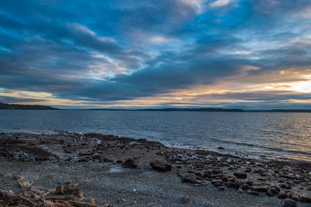 shorelines: Clouds hover over the Puget Sound. Shot taken in West Seattle, Washington. Stock Photo