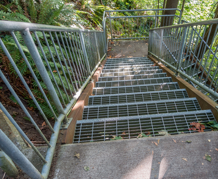 puget: Metal stairs criss-cross leading down to the Puget Sound at Eagle Landing Park in Burien, Washington.