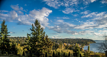 puget: View of a cloudy sky, the Puget Sound and Mount Rainier. Photo taken in Burien, Washington. Stock Photo