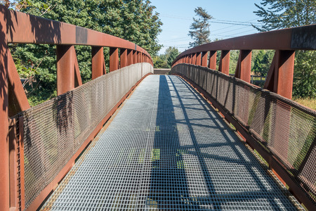 green river: A metal walking bridge spans the Green River in Washington State. Stock Photo