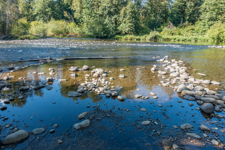 The Green River in Washington State is low revealing rocks. Stock Photo