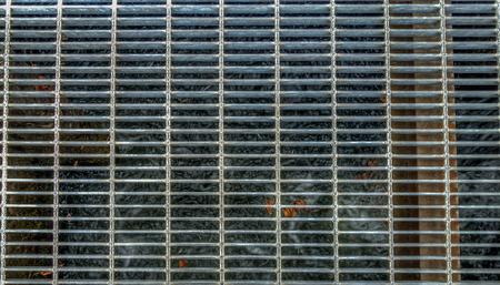 metal grate: HDR image of a metal grate over water. Stock Photo