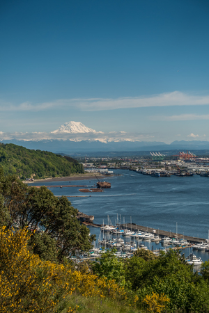 Majestic Mount Rainier rises up over the Port of Tacoma in Washington State.