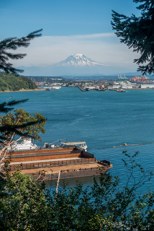A view of the Port of Tacoma with Mount Rainier in the distance. Stock Photo