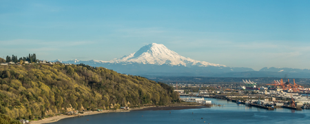 A panoramic view of majestic Mount Rainier towering over the Port of Tacoma.