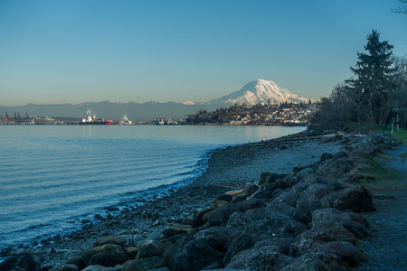 View of Mount Rainier from the Ruston area of Tacoma, Washington. The mountain glows in the evening twilight.