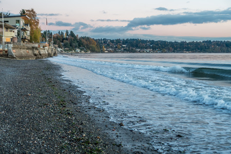 A seawall is oncovered at low tide at Three Tree Point in Burien, Washington.